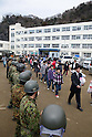 March 28, 2011, Ishonomaki, Japan - Thirty-six graduates of a public school in quake-hit Ishinomaki, Miyagi prefecture, are seen off by their teachers, parents and soldiers of Japan Ground Self-Defense Force after the graduation ceremony on Tuesday, March 28. The ceremony took place in the arts and crafts room of the school, which has become a temporary shelter for the victims of the March 11 magnitude 9.0 earthquake and 10-meter tsunami that followed. The JGSDF soldiers were on hand to retrieve graduation certificates from the vault toppled by the rushing tidal wave. (Photo by AFLO) [3609] -mis-