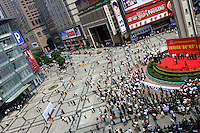 Residents gather in Chongqing city center, on Saturday, Apr. 23, 2005. Chongqing is at the heart of the government's Go West campaign, incouraging business and development away from China's east coast.