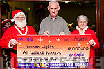 Tony Noonan from  Templeglantine  with the cheque for €4000 which he received from Energia for winning the All Ireland Title for the best  Christmassy House in Ireland.