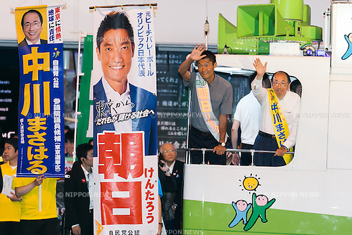 (L to R) Liberal Democratic Party candidates Kentaro Asahi and Masaharu Nakagawa greet supporters during a campaign event in Akihabara on July 9, 2016, Tokyo, Japan. Shinzo Abe, leader of the Liberal Democratic Party and Prime Minister of Japan delivered his last campaign speech before the July 10th House of Councillors elections. (Photo by Rodrigo Reyes Marin/AFLO)