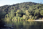 Woman swimming in Yuba River, South Fork