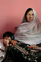 Commander Kaftar poses with her 3-year-old grand daughter Bibi Zora a the safe house she now lives in on the outskirts of Pul-e Khumri, a small city in Bahglan province in Afghanistan. <br />