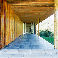 The porch at the entrance to the villa is clad in bamboo and has a slate floor
