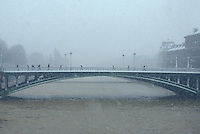 Paris - bridge in the snow - Photograph by Owen Franken