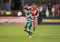 28 March 2012: Club Santos Laguna Osmar Mares #20 and Toronto FC foward/midfielder Ryan Johnson #9 in action during a CONCACAF Champions League game between the Club Santos Laguna and Toronto FC at BMO Field in Toronto..The game ended in a 1-1 draw...