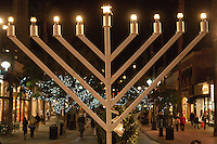 Nine flames burn on the giant menorah at the Third Street Promenade marking the last night of  Hanukkah on Wednesday, December 8, 2010.