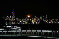 HOBOKEN, NJ - OCTOBER 16: A full Hunter's super moon rises behind middle Manhattan and Empire State Building in New York City on October 16, 2016 as seen from Hoboken, NJ, VIEWpress/Eduardo Munoz Alvarez