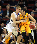 Northern Iowa Seth Tuttle guards Wyoming's larry Nance (22) 2015 NCAA Division I Men's Basketball Championship March 20, 2015 at the Key Arena in Seattle, Washington.   Northern Iowa beat Wyoming 71 to 54.   ©2015.  Jim Bryant Photo. All Rights Reserved.