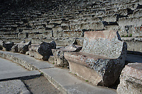 EPIDAURUS, GREECE - APRIL 15 : A detail of the seating in the Cavea of the Theatre, on April 15, 2007 in Epidaurus, Greece. The Theatre, designed by Polykleitos the Younger, was built in the late 4th century BC and extended in the Hellenistic period. It was rediscovered in 1881 and significantly restored in the 1950s.  It has the three main features of a Greek theatre: the orchestra, the skene and the cavea, a raked semi-circular auditorium with radiating diazomas. The theatre is renowned for its accoustics thanks to the symmetry of the cavea, seen here in the early morning. (Photo by Manuel Cohen)