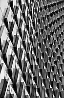 Pattern of windows which are angled out the glass fa&ccedil;ade of Ropemaker Place, London<br />