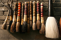 Calligraphy Brushes at Liulichang Market - The Liulichang is a famous district in Beijing that is known for its traditional Chinese architecture and also its antique market that sells various craftwork, artistry, calligraphy, inkstones and antiques. Its name Liulichang came from during the time of Ming Dynasty when a colored glaze factory produced glazed tiles for the palaces and temples in the city.   Liulichang was a favorite haunt for scholars, painters and calligraphers who gathered there to write and purchase books, as well as to paint and compose poetry but continues to thrive as a market aimed at tourists.