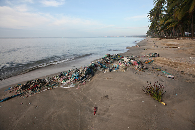 Old fishing nets are washed ashore on the beach in Mui Ne, Vietnam. Nov. 20, 2011.