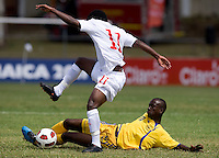 Chris Nanco (11) of Canda is tackled by Jabarry Chandler (11) of Barbados during the group stage of the CONCACAF Men's Under 17 Championship at Jarrett Park in Montego Bay, Jamaica. Costa Rica defeated El Salvador, 3-2.