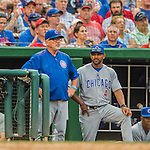 15 June 2016: Chicago Cubs Manager Joe Maddon (left) watches play from the dugout during a game against the Washington Nationals at Nationals Park in Washington, DC. The Cubs fell to the Nationals 5-4 in 12 innings, giving up the rubber match of their 3-game series. Mandatory Credit: Ed Wolfstein Photo *** RAW (NEF) Image File Available ***