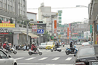 Xi Jia Dong Lu in Taichung City is the hub of a cancer betting syndicate that has become wildly popular with local punters over the last two years. The blue sign on the right of the frame is one such shop (translates as 'Charitable Caring Office'). At least a dozen betting shops or funeral homes located on this street are involved in organising betting on the timing of cancer patient deaths throughout Taiwan