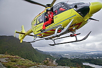 Crew from Norwegian Air Ambulance fly a training mission in the Bergen area. Doctor B&aring;rd Einar Heradstveit at the door. Pilot Marius Malmo.<br /> <br /> &copy;Fredrik Naumann/Felix Features