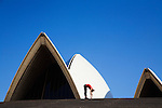 A runner stretches atop the steps of the Sydney Opera House. Sydney, New South Wales, AUSTRALIA.
