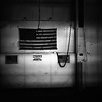 An American flag hangs in a closed Chrysler assembly plant in Newark, Delaware. The plant once served as a major employer in northern Delaware, and has since been demolished.