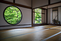 """Genko-an is famous for two large windows.  """"The Window of Enlightenment"""" is round, showing the harmony of the universe.  The squared window is called """"The Window of Confusion"""" symbolising humans' lives of suffering.  Both windows overlook the same garden, though the effect of looking through each window is quite different.  The garden's plants and stones are arranged to create an elegant world of wabi and sabi.  Genko-an Temple was originally built as a hermitage for the head priest of Daitoku-ji Temple, but was in time turned into a temple of the Soto sect of Zen Buddhism."""