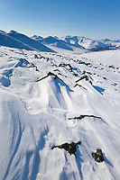 Wind blown snow covered mountain slopes in the White Mountains National Recreation Area, interior, Alaska