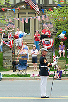 Spectators  Loyalty day patriotic parade in small town USA.