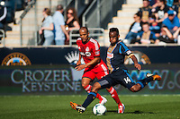 Amobi Okugo (14) of the Philadelphia Union passes the ball. Toronto FC and the Philadelphia Union played to a 1-1 tie during a Major League Soccer (MLS) match at PPL Park in Chester, PA, on April13, 2013.