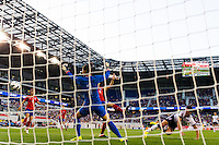 United States (USA) forward Abby Wambach (20) scores beating Korea Republic (KOR) goalkeeper Kim Jungmi (1). The women's national team of the United States defeated the Korea Republic 5-0 during an international friendly at Red Bull Arena in Harrison, NJ, on June 20, 2013.
