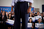 VIP guests watch as GOP presidential candidate Gov. Mitt Romney is introduced at a campaign rally at EIT LLC, and electronics design and manufacturing company, in Sterling, Virginia, June 27, 2012.