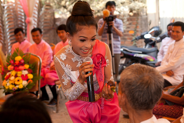 Singer at a buddhist wedding in a small village outside of Phnom Penh, Cambodia. <br /> <br /> Photos &copy; Dennis Drenner 2013.