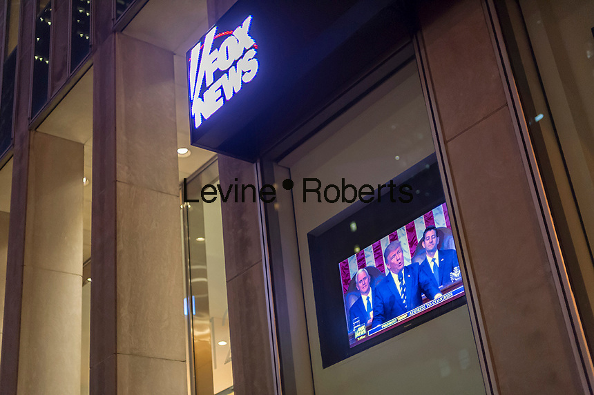 The News Corp. building in Midtown Manhattan in New York shows the Fox News broadcast below their news ticker of President Donald Trump's speech to a joint session of Congress on Tuesday, February 28, 2017.  (© Richard B. Levine)