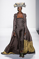 Model walks runway a DESERT SILK GAZAR LINEN GODDESS COAT BORDERED W/23K GOLDLEAF DESERT SILK GAZARLNEN STRAPLESS JUMPSUIT by Zang Toi, for the Zang Toi Spring 2012 My Dream Of North Africa Collection, during Mercedes-Benz Fashion Week Spring 2012.