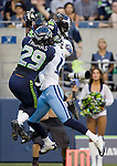 Seattle Seahawks' free safety Earl Thomas (29) and cornerback Richard Sherman goes up to defend against Tennessee Titans' wide receive Damian Williams, (C) at CenturyLink Field in Seattle, Washington on August 11, 2012.  Seahawks' Richard Sherman came up with the interception. ©2012. Jim Bryant Photo. All Rights Reserved...