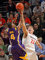 Jan. 2, 2011; Charlottesville, VA, USA; Virginia Cavaliers forward Will Sherrill (22) blocks the shot of LSU Tigers guard Chris Bass (4) during the game at the John Paul Jones Arena. Virginia won 64-50. Mandatory Credit: Andrew Shurtleff-