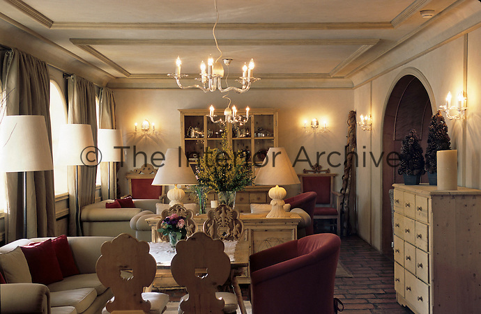 One of the drawing rooms with low tables and sofas for guests to relax at the Hotel & Spa Rosa Alpina in Alta Badia, Dolomites