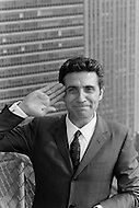 October 1966. French singer Gilbert Becaud saluting during a visit to New York. Image by © JP Laffont