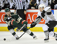 San Antonio Rampage defenseman Denny Urban, right, passes the puck past Iowa Wild center Mickey Lang during the first period of an AHL hockey game, Saturday, Jan. 25, 2014, in San Antonio (Darren Abate/AHL)