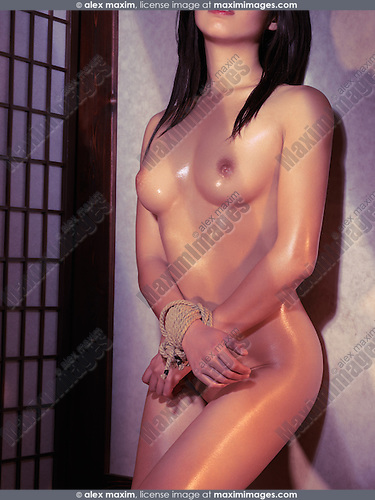 Naked Asian Woman Standing At A Wall With Tied Hands Bondage Shibari