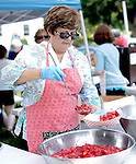 Southbury, CT- 14 June 2015-061415CM06- COUNTRY LIFE ONLY PLEASE  Linda Langley of Southbury prepares strawberry shortcake during the annual  Southbury Strawberry Festival at the United Church of Christ in Southbury on Sunday.  The event featured homemade strawberry shortcake, chocolate-covered strawberries, barbecued food, activities for children, pony rides, live music and dancing.  Christopher Massa Republican-American