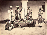 BNPS.co.uk (01202 558833)<br /> Pic: DominicWinter/BNPS<br /> <br /> A group of Pathans from the Peshawur Valley.<br /> <br /> Fascinating 150 year-old photographs of India taken in the aftermath of the failed mutiny have sold for almost &pound;8,000 at auction.<br /> <br /> The images, which date from 1863 to 1870, capture native soldiers with their weapons and picturesque landscapes and were taken by celebrated 19th century photographer Samuel Bourne.<br /> <br /> They went for a hammer price of &pound;6,400 to a private collector from America who bid online with extra fees pushing the overall price above &pound;7,800.<br /> <br /> Together with Charles Shepherd, Bourne set up photo studio Bourne &amp; Shepherd first in Simla in 1863 and later in Calcutta.