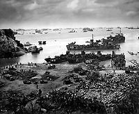A formidable task force carves out a beachhead, about 350 miles from the Japanese mainland.  Landing craft of all kinds blacken the sea out to the horizon, where stand the battlewagons, cruisers and destroyers.  Okinawa, April 13, 1945.  (Coast Guard)<br /> NARA FILE #:  026-G-4426<br /> WAR &amp; CONFLICT BOOK #:  1226