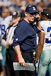 Dallas Cowboy Head Coach Jason Garrett sends in a play to quarterback Tony Romo in their game against the Seattle Seahawks'  at CenturyLink Field in Seattle, Washington on September 16, 2012.  The Seahawks beat the Cowboys 27-7. 2012. Jim Bryant Photo. ALL RIGHTS RESERVED.