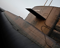 The Redoutable, first french nucleat submarine with ability of launching nuclear weapons build in cherbourg arsenal(1967, 1974 for nuclear missiles). It was demanteld in 1992 but the reactor is stocked for decades because of radioactivity.