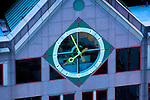 Exterior clock sits at the top of a high rise office building in Boston, MA.