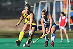 15 November 2015: Michigan's Caroline Chromik (4) and North Carolina's Lauren Moyer (2). The University of North Carolina Tar Heels played the University of Michigan Wolverines at Francis E. Henry Stadium in Chapel Hill, North Carolina in a 2015 NCAA Division I Field Hockey Tournament Quarterfinal match. UNC won the game 1-0.