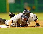 13 June 2006: Clint Barmes, infielder for the Colorado Rockies, dives safely back to first during a game against the Washington Nationals at RFK Stadium, in Washington, DC. The Rockies defeated the Nationals 9-2 in the second game of the four-game series...Mandatory Photo Credit: Ed Wolfstein Photo..