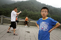 "Tourists visiting the Dujiangyan Irrigation System. The system is regarded as an ""ancient Chinese engineering marvel."" By naturally channeling water from the Min River during times of flood, the irrigation system served to protect the local area from flooding and provide water to the Chengdu basin. Sichuan Province. 2010"