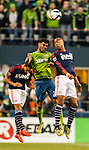 Seattle Sounders Lamar Neagle (27) heads the ball against  New England Revolution Teal Bunbury during an MLS match on March 8, 2015 in Seattle, Washington.  The Sounders beat the Revolution 3-0.  Jim Bryant Photo. ©2015. All Rights Reserved.