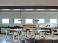 In the huge kitchen-diner of a contemporary Marfa ranch house there is ample room for a ten-seater refectory table