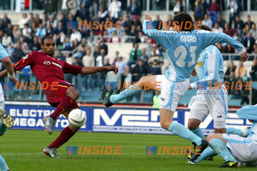 Roma 21/4/2004 Campionato Italiano Serie A <br /> Lazio - Roma 1-1 <br /> Emrson (Roma) challenged by Paolo Negro (Lazio)<br /> Lazio and Roma are playing again after it was suspended on March 21, 2004, for security reasons.  <br /> Foto Andrea Staccioli Insidefoto