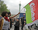 A woman with a flag of Parti de Gauche, another of the French socialist parties supporting Hollande in the second electoral round.